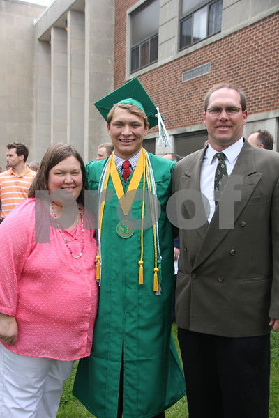 After Saint Edmond graduation ceremony  held on May 17, 2015, members of the Szalat family  posed for a picture. They are from left to right : Jenni Szalat, Ryan Szalat, and Mike Szalat