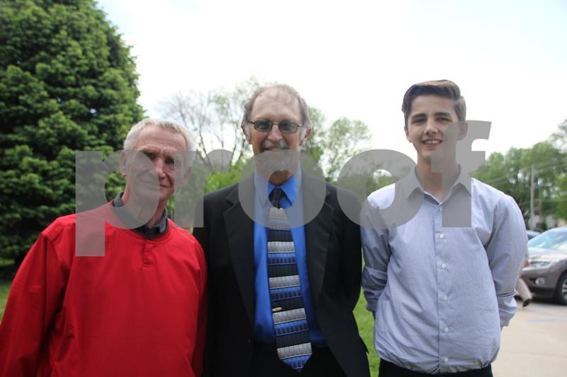 (left to right) Brad Baker,  Kent Johnson, and Dean Dencklau stopped briefly for a quick picture after the Saint Edmonds graduation ceremony on May 17, 2015