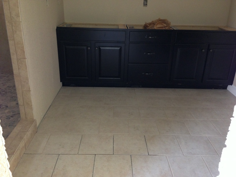 Master Bath - Java Knotty Alder - standard tile with upgrade accent.