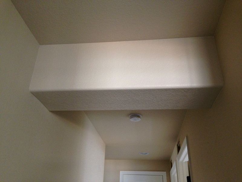 Soffit in hallway to master bedroom - not in model?