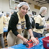 United Way of North Central Massachusetts and St. Bernard's Central Catholic High School held their Saints Against Hunger event, Nov. 20, 2019. The students packaged over 35,000 meals which helped the United Way reach 1,000,000 meals packaged. Student Rominna Grandich helped out by sealing the packages of food during the event. SENTINEL & ENTERPRISE/JOHN LOVE