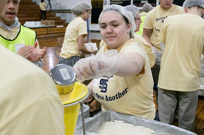 United Way of North Central Massachusetts and St. Bernard's Central Catholic High School held their Saints Against Hunger event, Nov. 20, 2019. The students packaged over 35,000 meals which helped the United Way reach 1,000,000 meals packaged. Student Bailey Acardi helps make meals during the event. SENTINEL & ENTERPRISE/JOHN LOVE
