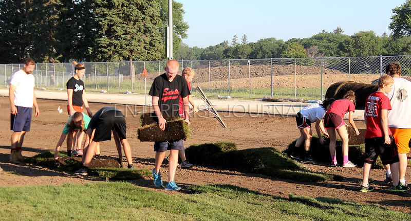 The new football field is making great progress after nine total loads of sod were laid on the new field. The Saints will host their first game on the new field on August 28, 2015 against Newman Catholic. (EJ Photo/ Angie Hansen)
