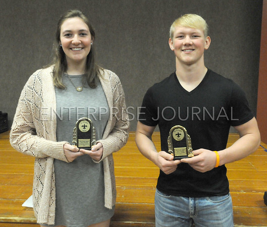Elizabeth Jenkins (left) and Dayton Smith are the recipients of this year's Bill and Dorothy Hegland Memorial Scholarship, awarded at the 21st Annual St. Ansgar Booster Club Athletic Banquet. EJ Photo/ Colby Fossey