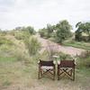 Two seats by the river at Sala's camp, Masai Mara
