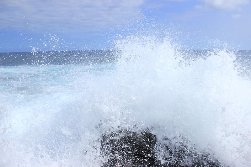wave crashing around rock at southernmost point in United States