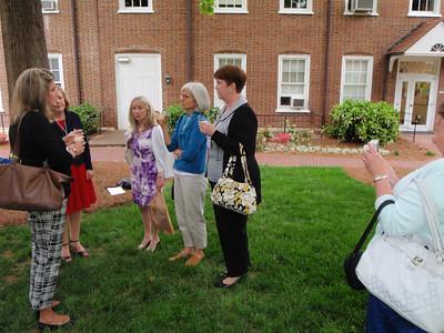 Jennifer Coe, Julia McM, Leigh Bullard, Louise W, Ann R celebrating at bench in front of Science Building