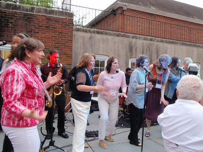 C'78 dancing and singing onstage with the band