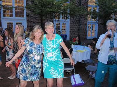 Liz Baird C'83 (Raleigh Salem Alum) in turquoise dress with friend