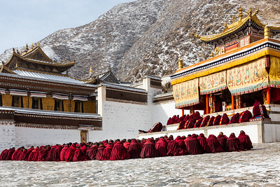 Monks sitting in Labrang Monastery