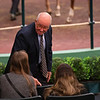 Ryan Mahan talks with buyers as he finishes his shift and heads to the sales meeting room.<br /> Keeneland January Horses of all ages sales on<br /> Jan. 15, 2020 Keeneland in Lexington, KY. Photo: Anne M. Eberhardt