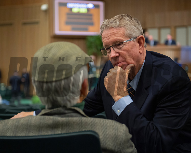 Scott Caldwell, right, talks with Stanley Petter during the sale. Keeneland January Horses of all ages sales on Jan. 17, 2020 Keeneland in Lexington, KY. Photo: Anne M. Eberhardt