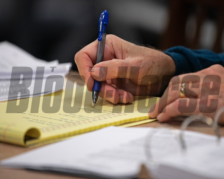 John Henderson writing up notes from visit to barn area before sales. Scenes during the Keeneland January sales on Jan. 11, 2020 Keeneland in Lexington, KY. Photo: Anne M. Eberhardt