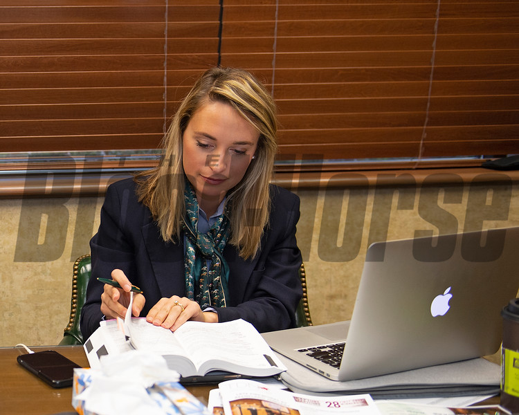 Gabby Gaudet researching updates before announcing on. the Keeneland auction stand.<br /> Keeneland January Horses of all ages sales on Jan. 15, 2020 Keeneland in Lexington, KY. Photo: Anne M. Eberhardt