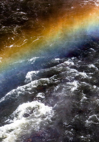 Rainbow over Rough Waters