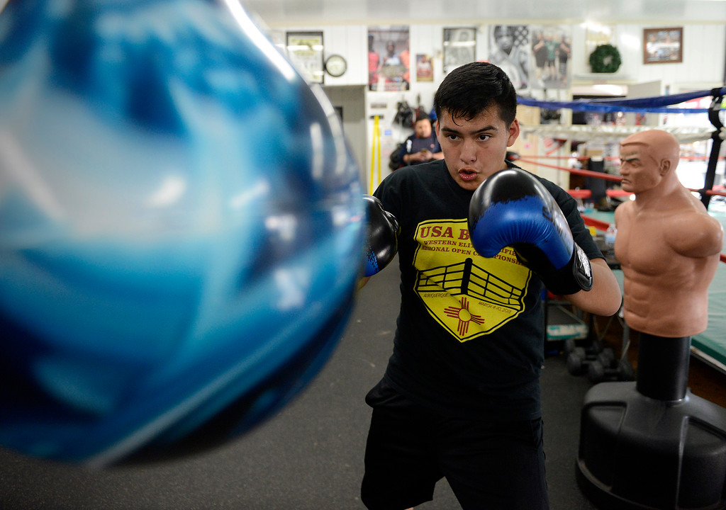 . Salinas Boxing Club fighter Jose Picazo, 12, hits the speed bag during training at the Salinas Boxing Club on Thursday, March 22, 2018.  (Vern Fisher - Monterey Herald)