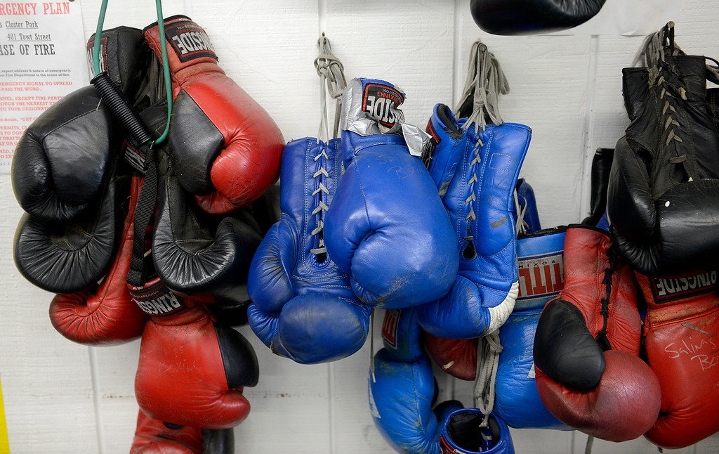 . Well worn boxing gloves hang on a wall at the Salinas Boxing Club on Thursday, March 22, 2018.  (Vern Fisher - Monterey Herald)