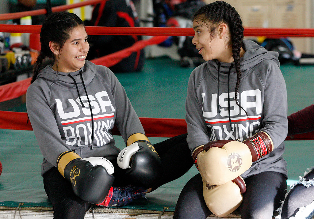 . Salinas Boxing Club fighters Iris Rivera, 17, and Maria Jardines, 14, at the Salinas Boxing Club on Thursday, March 22, 2018.  (Vern Fisher - Monterey Herald)