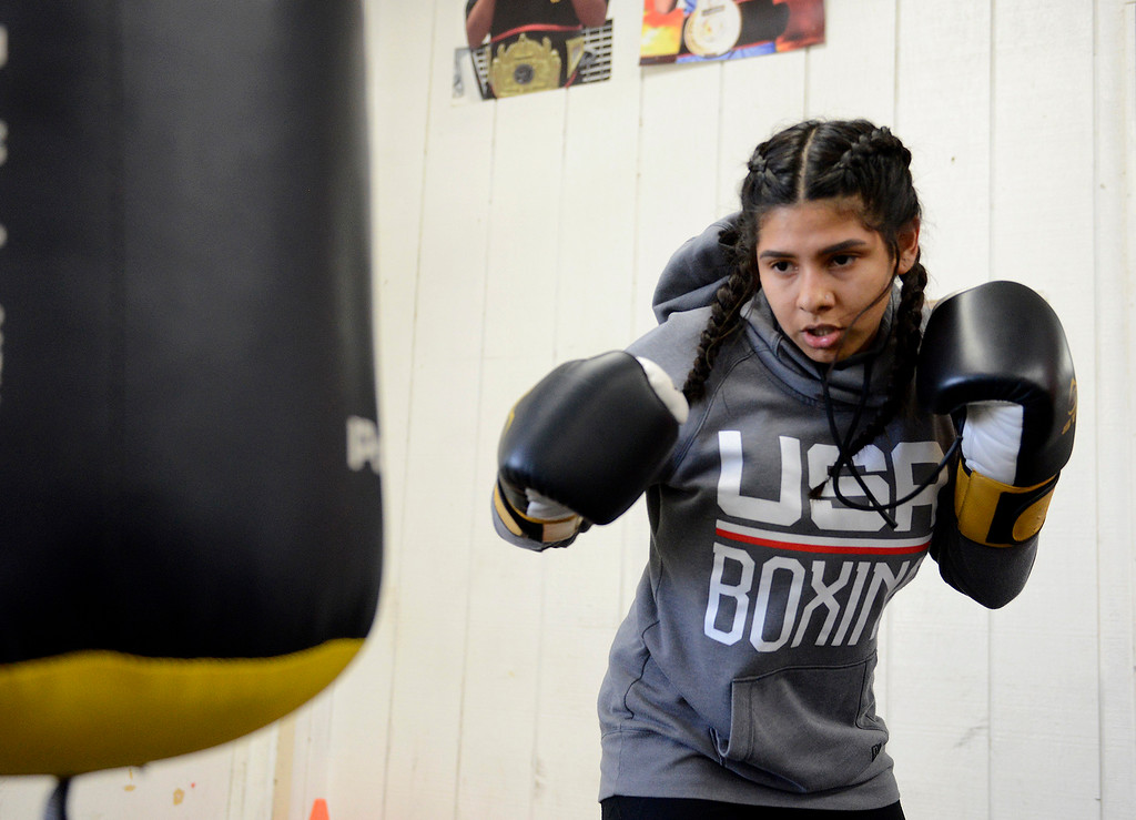 . Salinas Boxing Club fighter Iris Rivera, 17, hits the heavy bag during training at the Salinas Boxing Club on Thursday, March 22, 2018.  (Vern Fisher - Monterey Herald)