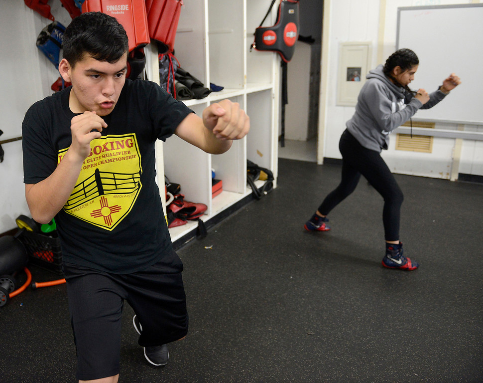 . Salinas Boxing Club fighters Jose Picazo, 12, and Iris Rivera, 17, at the Salinas Boxing Club on Thursday, March 22, 2018.  (Vern Fisher - Monterey Herald)