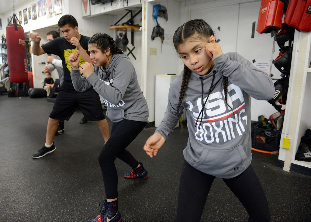 . Salinas Boxing Club fighters Jose Picazo, 12, Iris Rivera, 17, and Maria Jardines, 14, train at the Salinas Boxing Club on Thursday, March 22, 2018.  (Vern Fisher - Monterey Herald)