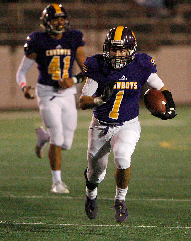 . Salinas\' Sunnie Arreola (1) runs for yards in the first half of their game against Monte Vista Christian in Salinas on Friday, Oct. 20, 2017.  (Vern Fisher - Monterey Herald)