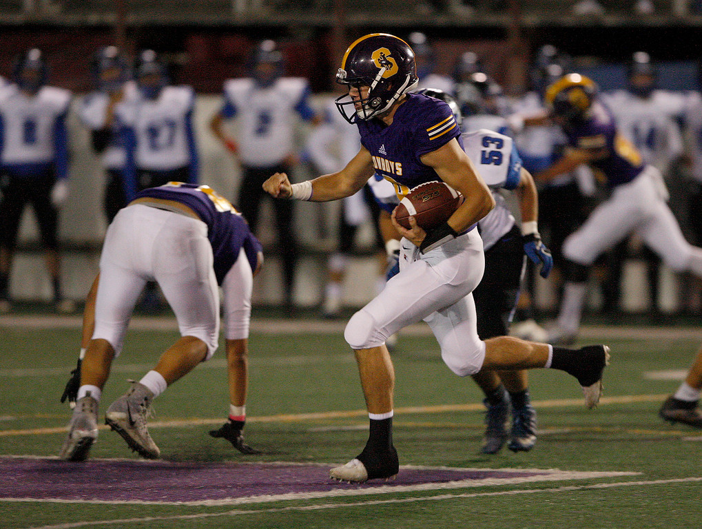 . Salinas\' Brett Reade (9) runs for yards in the first half of their game against Monte Vista Christian in Salinas on Friday, Oct. 20, 2017.  (Vern Fisher - Monterey Herald)