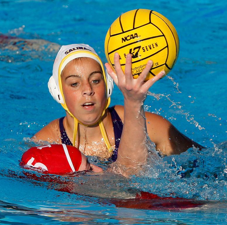 . Salinas\' Miranda Wilson (15) plays tough defense against Carmel\'s Kelly Rice (15) during their game in Carmel on Thursday, Sept. 28, 2017.  (Vern Fisher - Monterey Herald)