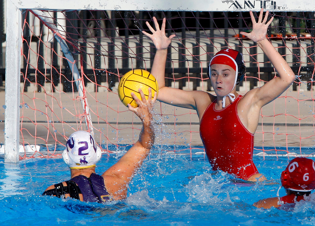 . Salinas\' Sabrie Flynn (2) takes a shot on goal as Carmel\'s Sophia Supica (1) attempts a block during their game in Carmel on Thursday, Sept. 28, 2017.  (Vern Fisher - Monterey Herald)