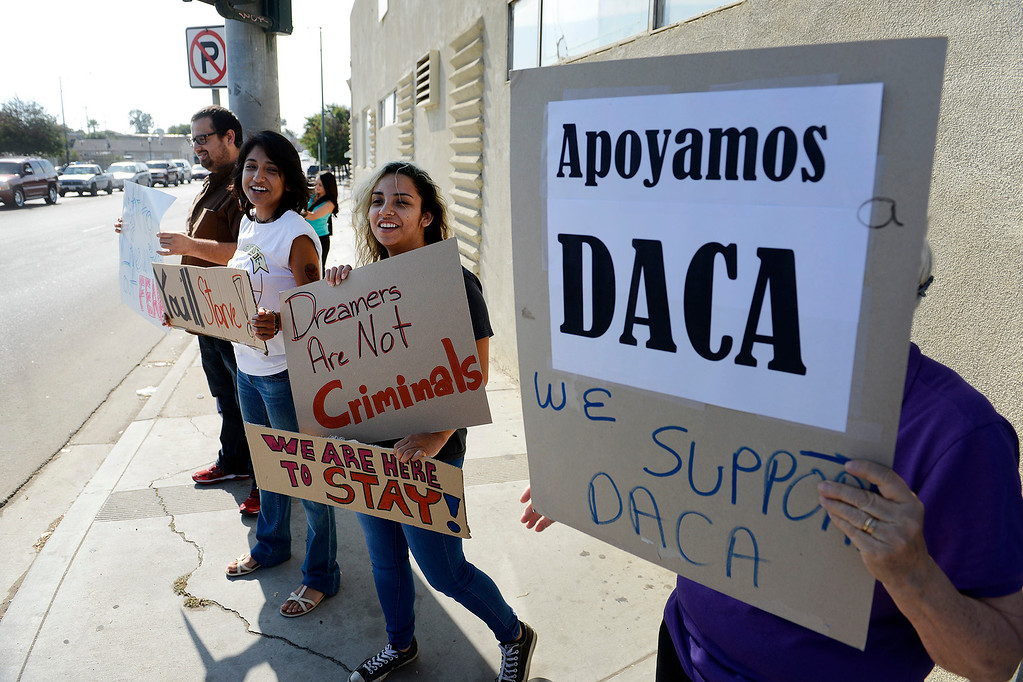 . Janet Solis and Andrea Leon from Salinas participates in a rally in support of DACA in Salinas on Tuesday, Sept, 5, 2017.  (Vern Fisher - Monterey Herald)