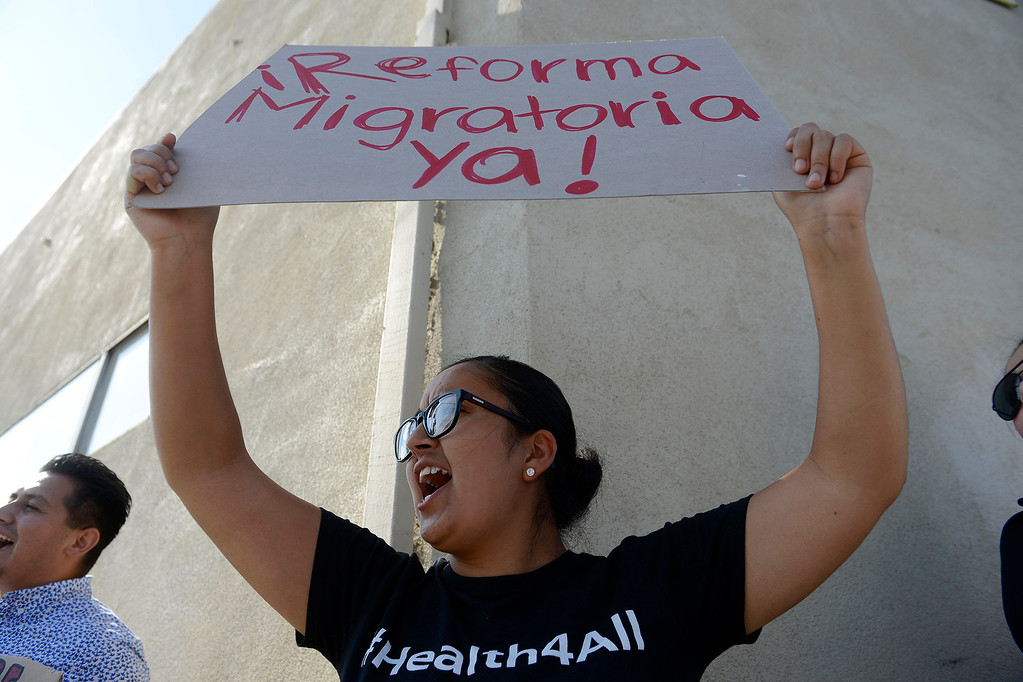. Monica Palomo from Salinas participates in a rally in support of DACA in Salinas on Tuesday, Sept, 5, 2017.  (Vern Fisher - Monterey Herald)