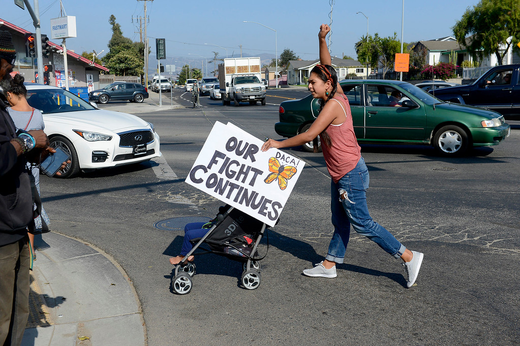 . Cristal Gonzalez from San Juan Bautista participates in a rally in support of DACA in Salinas on Tuesday, Sept, 5, 2017.  (Vern Fisher - Monterey Herald)