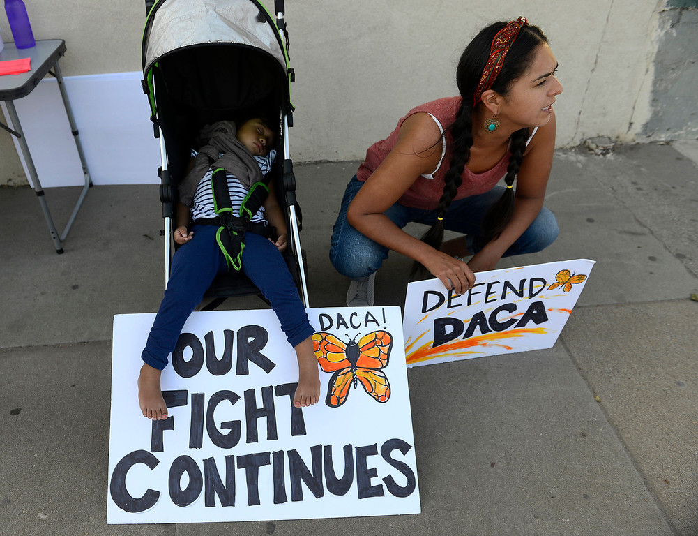 . Cristal Gonzalez from San Juan Bautista participates in a rally with her young child in support of DACA in Salinas on Tuesday, Sept, 5, 2017.  (Vern Fisher - Monterey Herald)