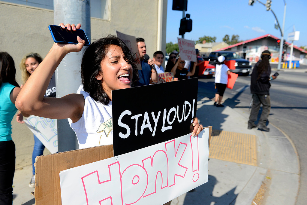 . Janet Solis from Salinas participates in a rally in support of DACA in Salinas on Tuesday, Sept, 5, 2017.  (Vern Fisher - Monterey Herald)