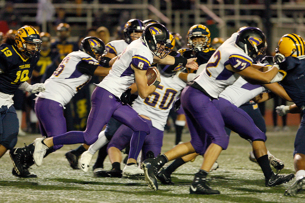 . Salinas High\'s Brett Reade (9) runs with the ball in the second half of their Central Coast Section Open Division I championship football game in San Jose against Milpitas High School on Friday, December 1, 2017.  (Vern Fisher - Monterey Herald)