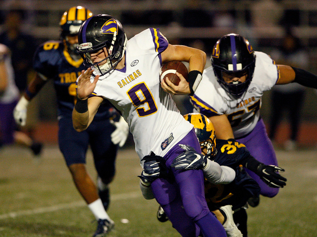 . Salinas High\'s Brett Reade (9) runs with the ball in the first half of their Central Coast Section Open Division I championship football game in San Jose against Milpitas High School on Friday, December 1, 2017.  (Vern Fisher - Monterey Herald)