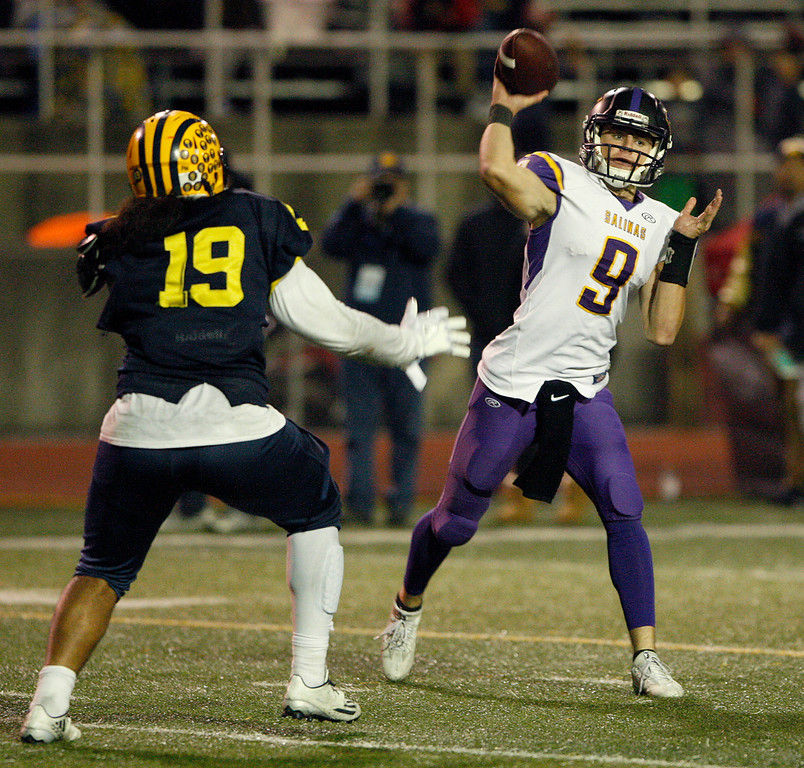 . Salinas High\'s Brett Reade (9) attempts a pass as Milpitas High defender Ioane Vete (19) applies pressure in the second half of their Central Coast Section Open Division I championship football game in San Jose on Friday, December 1, 2017.  Salinas High won the championship 25-18.  (Vern Fisher - Monterey Herald)