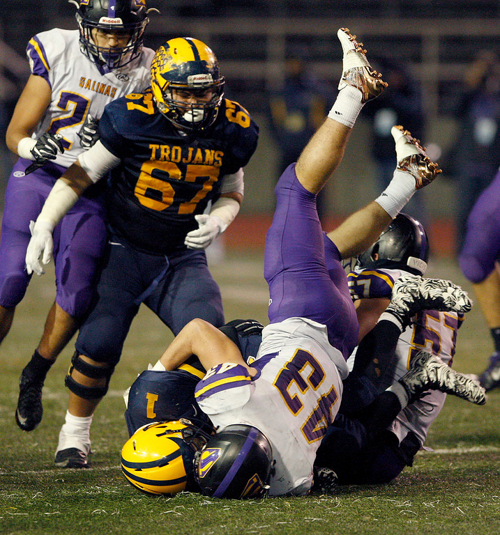 . Salinas High\'s Alex Guerrero (43) tackles Milpitas High Tyree Bracy (1) in the second half of their Central Coast Section Open Division I championship football game in San Jose on Friday, December 1, 2017.  Salinas High won the championship 25-18.  (Vern Fisher - Monterey Herald)