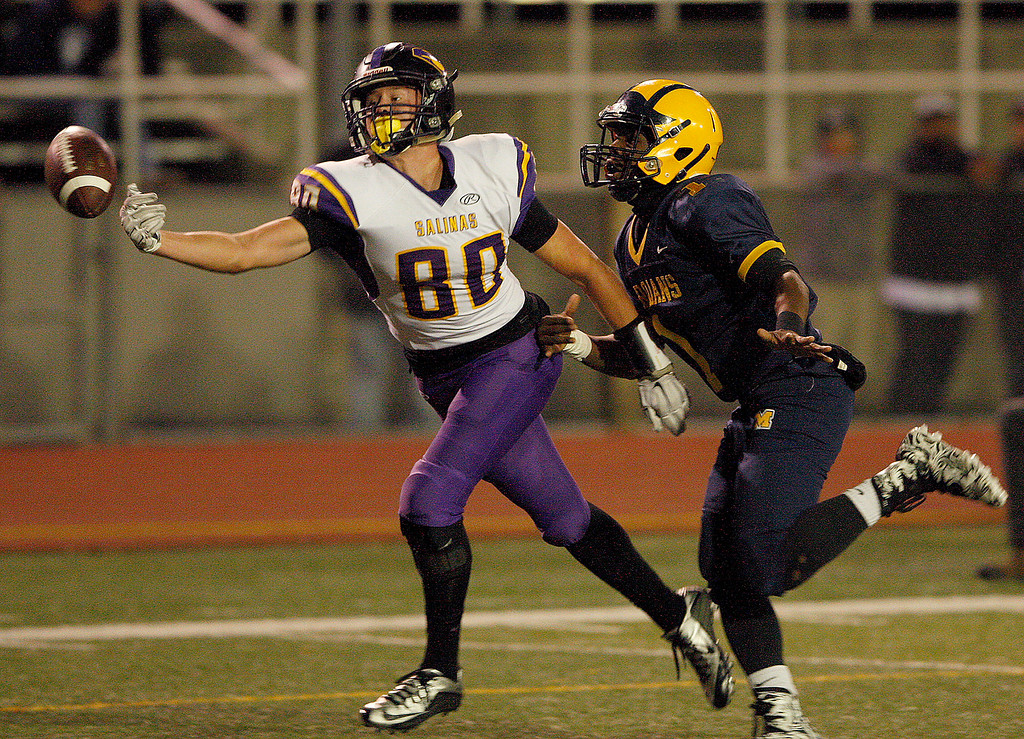 . Salinas High\'s Jeffrey Weimer (80) misses a pass while being defended by Milpitas High\'s Tyree Bracy (1) in the first half of their Central Coast Section Open Division I championship football game in San Jose on Friday, December 1, 2017.  (Vern Fisher - Monterey Herald)