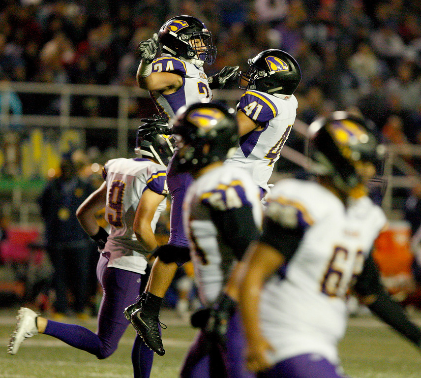 . Salinas High\'s Richard Cerda (24) celebrates his touchdown with Mike Cortez (41) in the second half of their Central Coast Section Open Division I championship football game against Milpitas High in San Jose on Friday, December 1, 2017.  Salinas High won the championship 25-18.  (Vern Fisher - Monterey Herald)