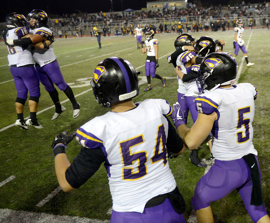. Salinas High celebrates their 25-18 victory over Milpitas High during their Central Coast Section Open Division I championship football game in San Jose on Friday, December 1, 2017.  (Vern Fisher - Monterey Herald)