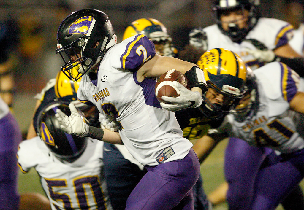 . Salinas High\'s Kelly McDermott (2) runs the ball in the first half of their Central Coast Section Open Division I championship football game against Milpitas High in San Jose on Friday, December 1, 2017.  Salinas High won the championship 25-18.  (Vern Fisher - Monterey Herald)