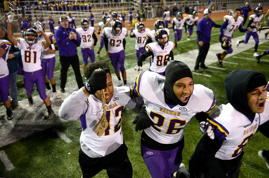 . Salinas High players celebrate their 25-18 victory over Milpitas High during their Central Coast Section Open Division I championship football game in San Jose on Friday, December 1, 2017.  (Vern Fisher - Monterey Herald)