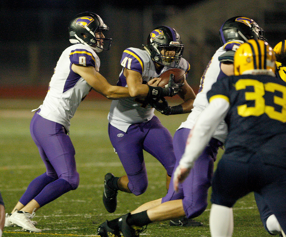 . Salinas High\'s Brett Reade (9) hands the ball off to running back Mike Cortez (41) in the first half of their Central Coast Section Open Division I championship football game against Milpitas High in San Jose on Friday, December 1, 2017.  Salinas High won the championship 25-18.  (Vern Fisher - Monterey Herald)