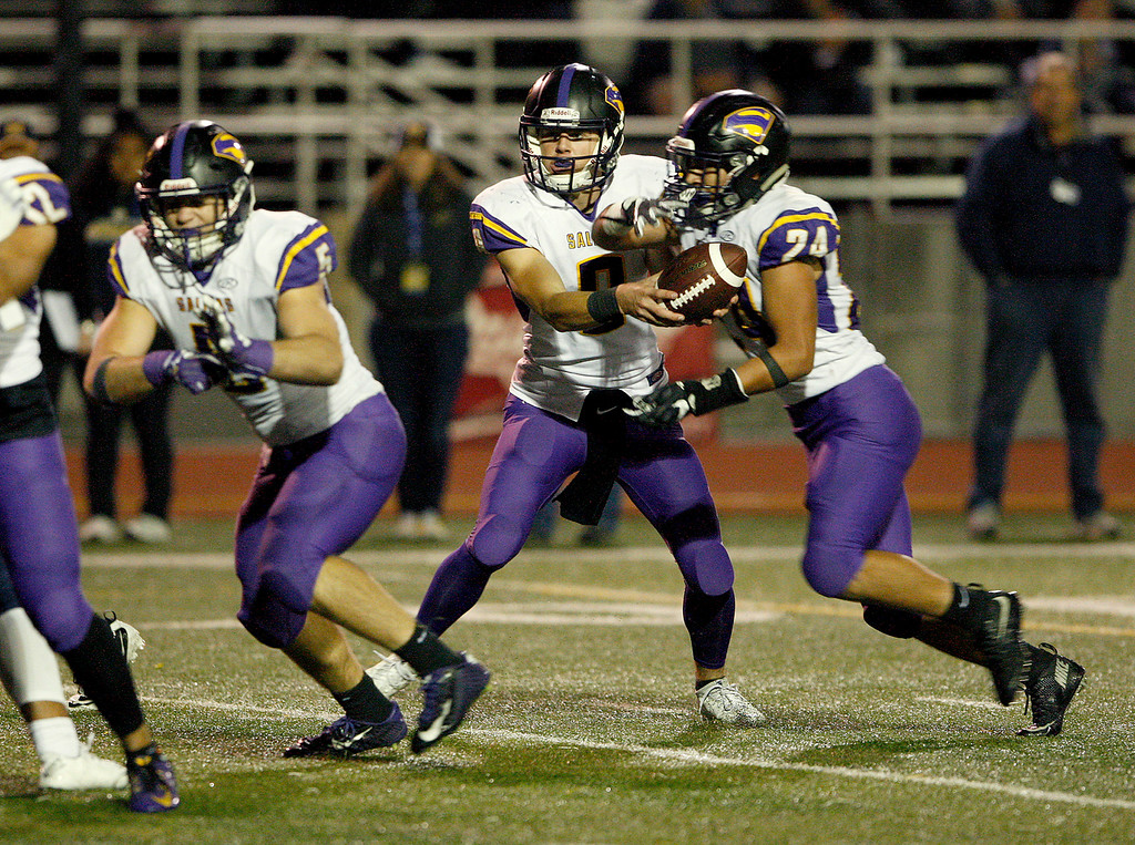 . Salinas High\'s Brett Reade (9) hands the ball off to Richard Cerda (24) as he rushes for a touchdown in the second half of their Central Coast Section Open Division I championship football game against Milpitas High in San Jose on Friday, December 1, 2017.  Salinas High won the championship 25-18.  (Vern Fisher - Monterey Herald)