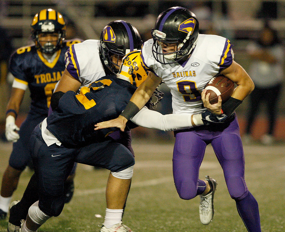 . Salinas High\'s Brett Reade (9) tries to elude Milpitas High\'s PJ Vai (2) in the first half of their Central Coast Section Open Division I championship football game in San Jose on Friday, December 1, 2017.  Salinas High won the championship 25-18.  (Vern Fisher - Monterey Herald)