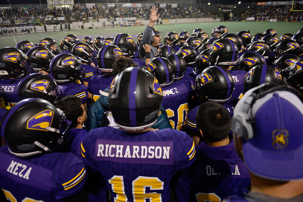 . Salinas High head coach Steve Zenk rallies his players in the first half of their Division 4-AA CIF State Football Championship Bowl Game against Placer High School on Friday, Dec. 8, 2017 in Salinas.  Placer High beat Salinas High in overtime 43-42 to advance to the CIF State Final.  (Vern Fisher - Monterey Herald)