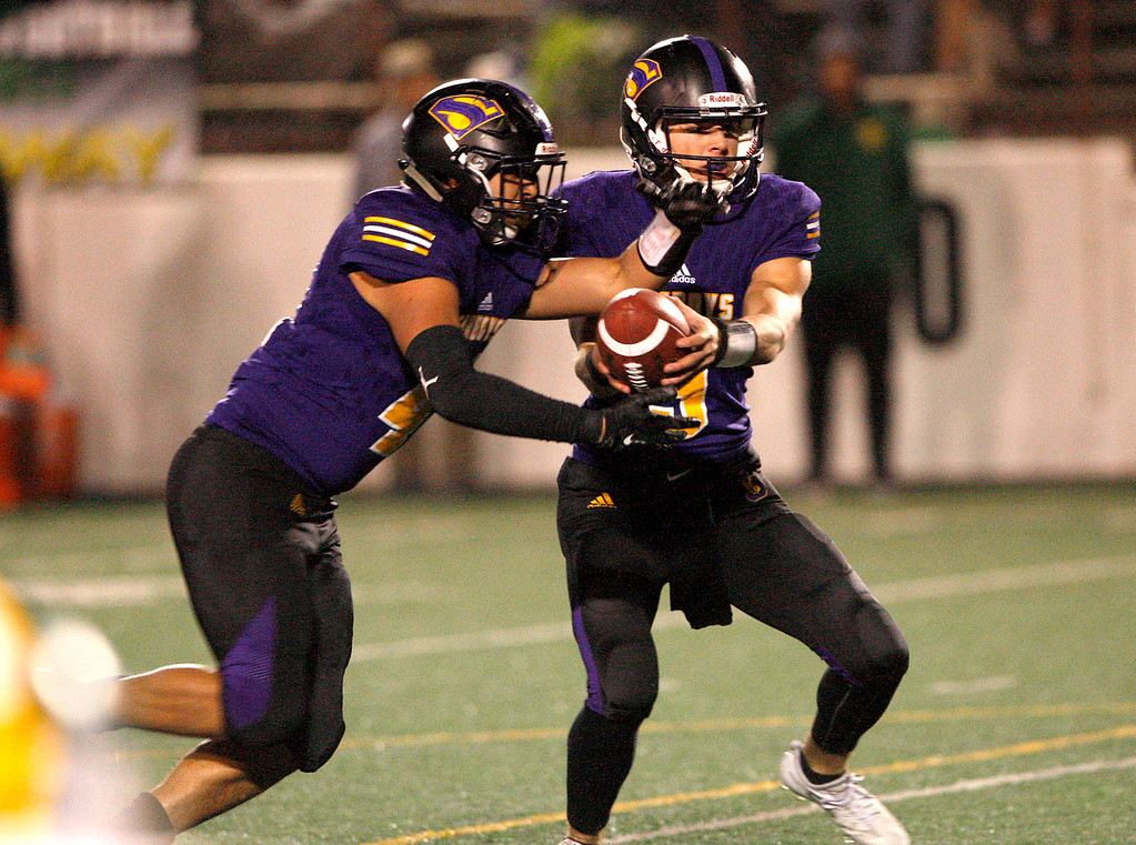 . Salinas High running back Mike Cortez (41) receives a handoff from quarterback Brett Reade (9) in the first half of their Division 4-AA CIF State Football Championship Bowl Game against Placer High School on Friday, Dec. 8, 2017 in Salinas.  Placer High beat Salinas High in overtime 43-42 to advance to the CIF State Final.  (Vern Fisher - Monterey Herald)