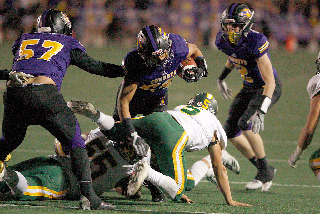 . Salinas High running back Richard Cerda (24) runs for a touchdown in the first half of their Division 4-AA CIF State Football Championship Bowl Game against Placer High School on Friday, Dec. 8, 2017 in Salinas.  Placer High beat Salinas High in overtime 43-42 to advance to the CIF State Final.  (Vern Fisher - Monterey Herald)