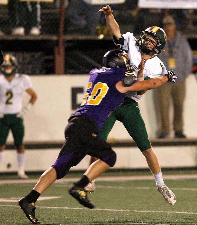 . Salinas High defender Noah Habes (50) puts a hit on Placer High quarterback Michael Stuck (6) in the second half of their Division 4-AA CIF State Football Championship Bowl Game on Friday, Dec. 8, 2017 in Salinas.  Placer High beat Salinas High in overtime 43-42 to advance to the CIF State Final.  (Vern Fisher - Monterey Herald)